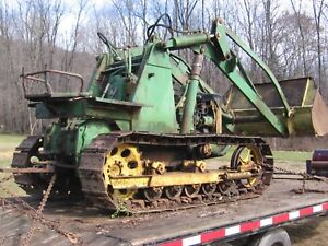 Looking for John deere 420C 5 roller with Henry loaders.