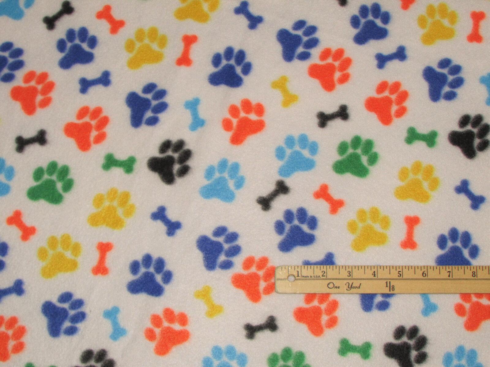 bright dog paws and bones fleece fabric