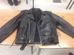 Biker leather jacket for sale, includes leather vest as well.
