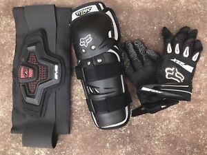 Asst Motocross gear Fox gloves shin pads and kidney belt