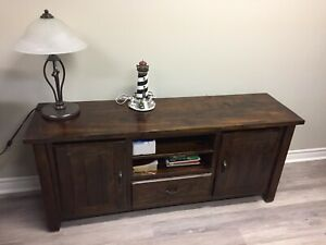 Solid wood TV table, brown walnut color.