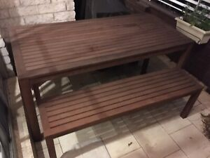 Outdoor table and benches with cushions