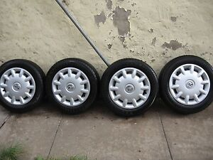 HOLDEN BARINA 4 x NEW TYRES 175/65 R14 WITH WHEEL COVER! CHEAP!!! Wollongong Wollongong Area Preview