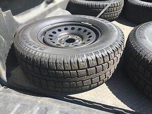 Like new Chev 1/2 ton tires.
