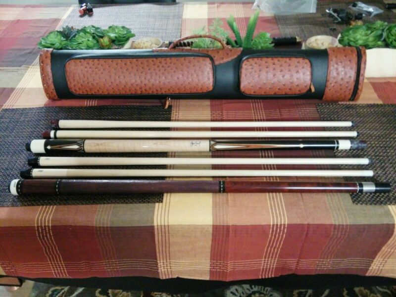 Used joss cue with 2 shafts and break cue and case 2x4