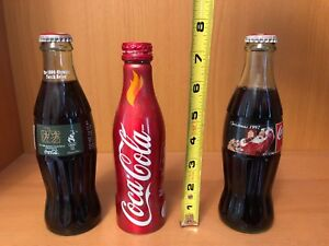 Vintage Coca-Cola bottles Olympic/ Christmas (full)