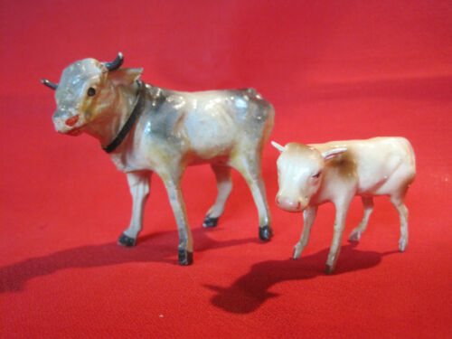 Antique German putz cow and calf, stick legs composition body nativity display