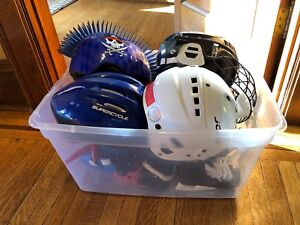 Young kids sports gear: skates, helmets, ball gloves