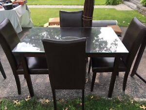 Dining set - glass top table with 4 chairs