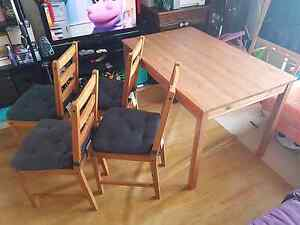 Wooden Dining table with 4 chairs and seat covers (ikea) Homebush West Strathfield Area Preview