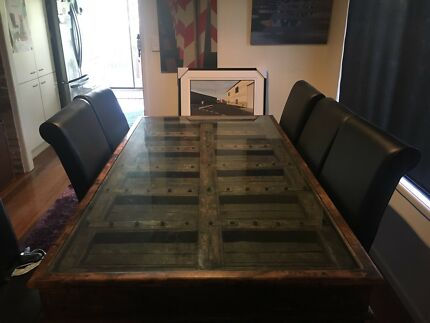 Antique Indian temple door table with 8 high back leather chairs