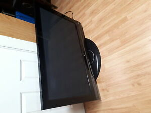 "FLAT SCREEN 42""TV ( LG ) A VENDRE $125."