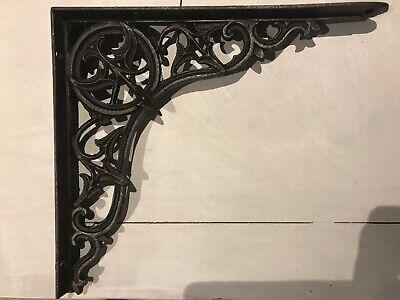 Single ornate cast iron shelf bracket