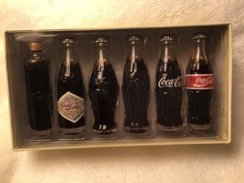 Evolution of the Coca Cola Contour Bottle 1899-1999 Set of Miniature Bottles