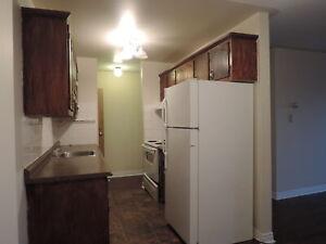2 Bedrooms-  heat,hw, patio,ground level, ,laundry, security