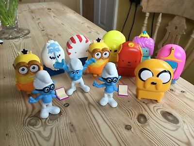 12 McDonald's toys Including 3 Smurfs, 2 Minions + others