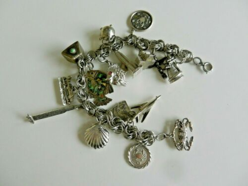 Silver charm bracelet with 16 charms