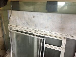 Free storm windows and glass. Hot house/greenhouses