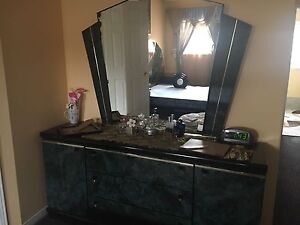 Queen bed with dresser and two night stands
