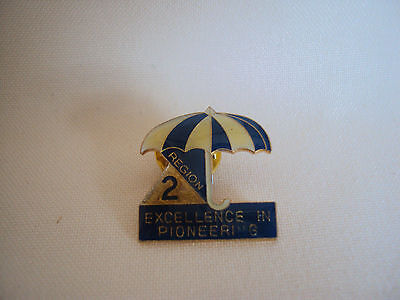 COLLECTIBLE 2 EXCELLENCE IN PIONEERING OLD ENAMEL PIN