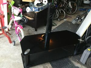 Television stand with mounting brackets