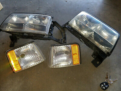 1996 1997 1999 Cadillac Deville headlights OEM used with bulbs
