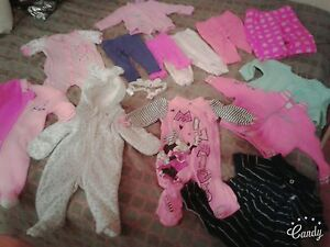 Assorted baby clothes and items