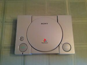 PS1 with game and controller