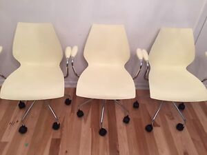 Kartell arm chairs