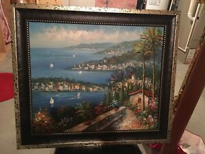 Sea near houses painting with brown frame