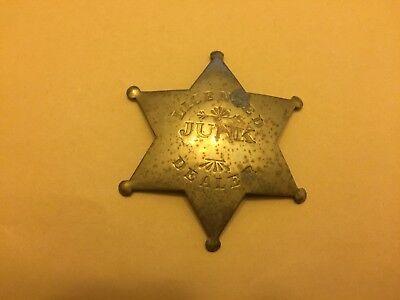 Vintage Brass Tone Licensed Junk Dealer Pin Badge