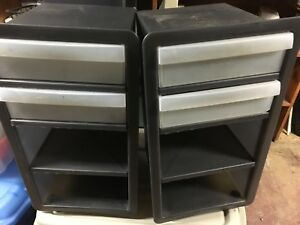 Five plastic wheely storage cabinets.