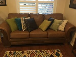 Three seater tan leather couch