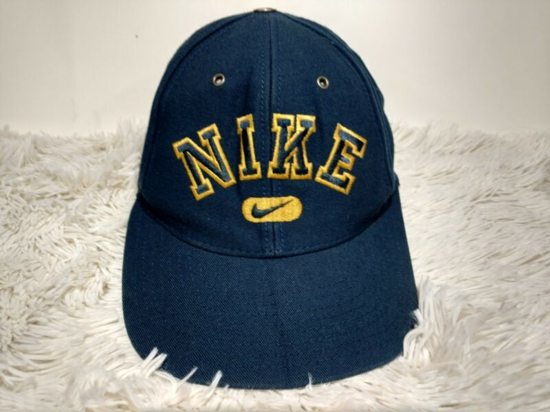23503e6d9111f Vintage 90s Nike Spellout Logo Snapback Hat Swoosh Dad Cap Blue Yellow  Damaged