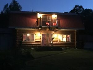 Beautiful log cabin on 12 private acres