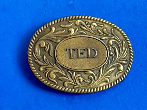 Vintage 1977 western name   TED.    flower swirl belt buckle by The Kinney Co.