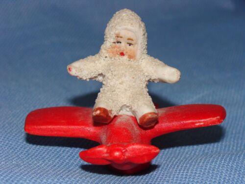 Cute Snow Baby Riding an Airplane