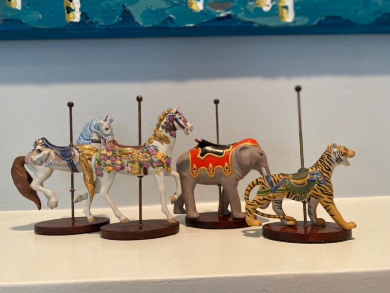 Franklin mint carousel collectible pieces (4)