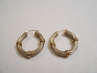 - 14K YELLOW GOLD / STERLING FUSION BANGLE EARRINGS.