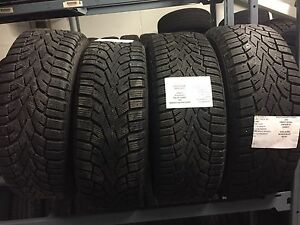 4 almost new winter tires on OEM Honda steel wheels