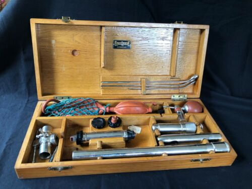 Antique medical instruments in Wooden box.