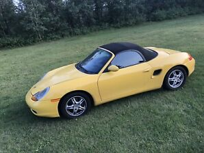 **Porsche Boxster, buttercup yellow, convertible**