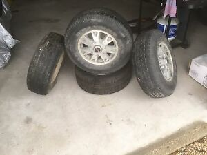 Tires, rims, and set of brakes and rotors