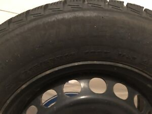 "Hardly worn 16"" studded tires on steel rims 215/65R16"