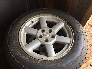 Jeep Liberty rims and tires. Lots of tread left. Need gone