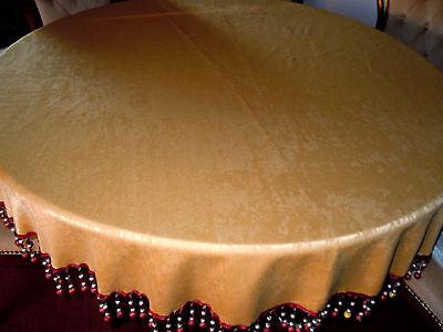 Raität: Wunderschöne ockerfarbene Tischdecke mit breiter Perlenfransenborte rund