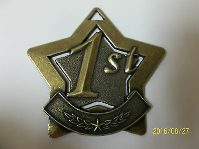 1st place star shaped gold medal, w/ engraving, 2