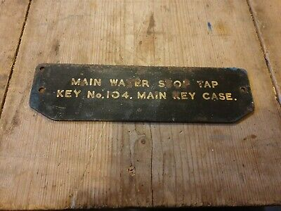 Old shabby vintage metal sign mains water stop tap