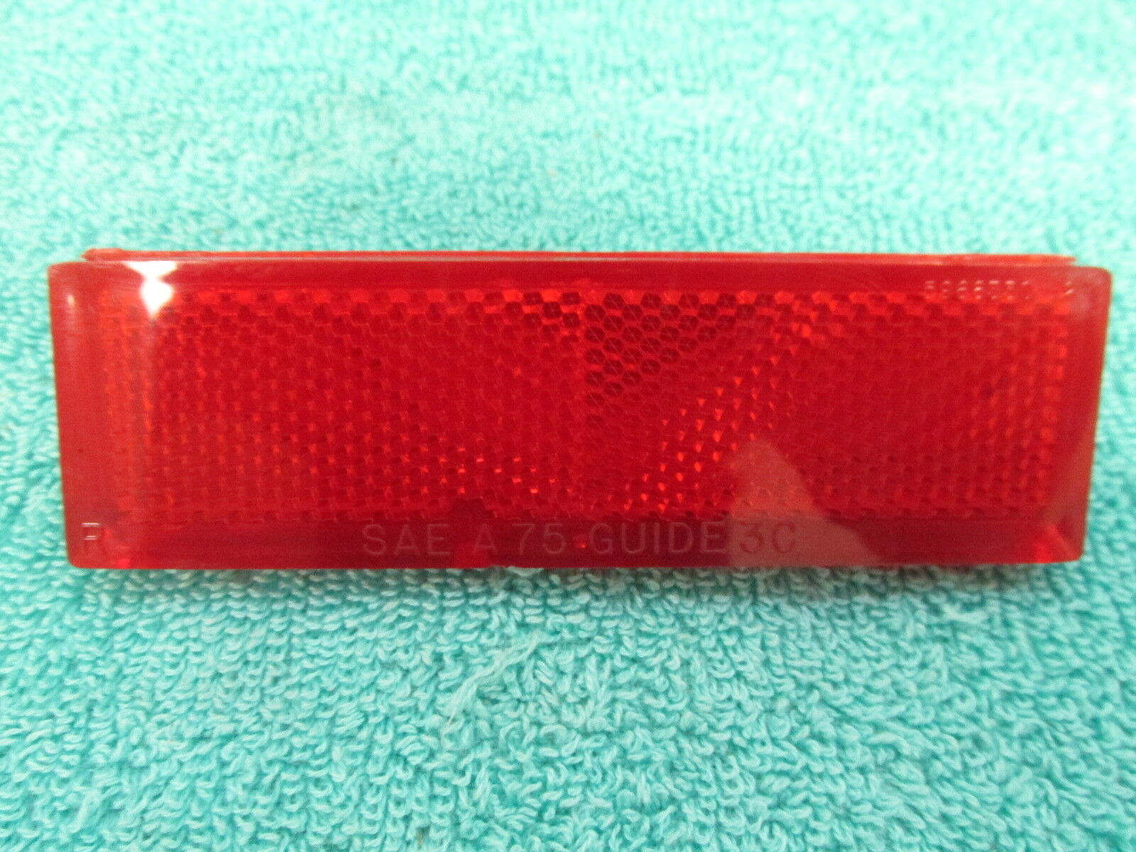 1975 OLDSMOBILE 98  RH  TAIL PANEL TRUNK REFLECTOR   NOS GM  317