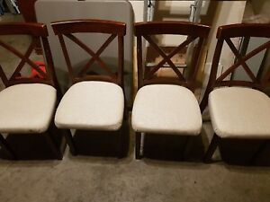 4 wooden chairs and matching dinning table